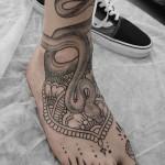 ヘビとトライバルのタトゥーSnake,Tribal Tattoo,刺青・タトゥースタジオ 女性彫師 恵華-Keika-